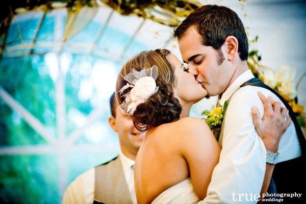 San Diego Wedding Photographers: Bride and grooms first kiss at Berardo Winery wedding