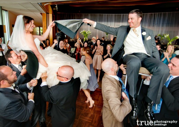 San Diego Wedding Photography: Bride and Groom during hora at Scripps Seaside Forum wedding reception