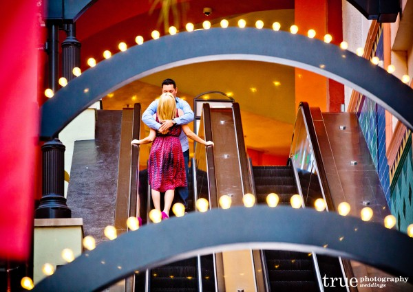 San Diego Wedding Photographers photograph engagement shoot on an escalator in downtown San Diego