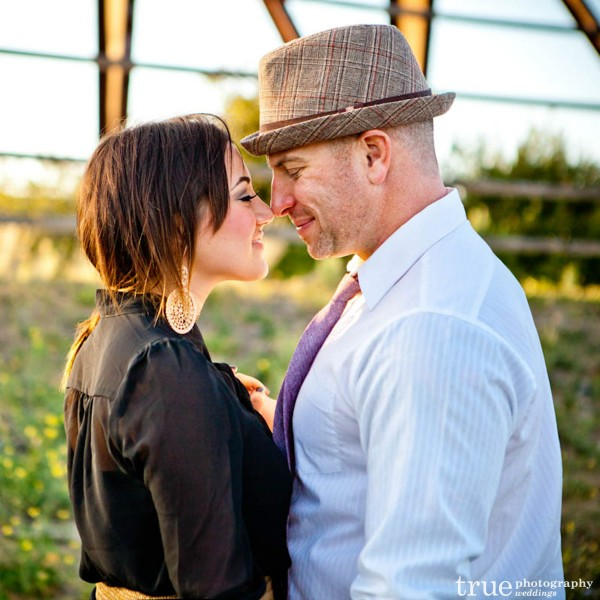 San Diego Wedding Photography: Engaged couple kissing during engagement shoot at the Oceanside Swap Meet