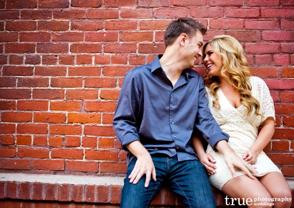 San Diego Wedding Photography: Engagement Photos in front of brick wall in Downtown San Diego