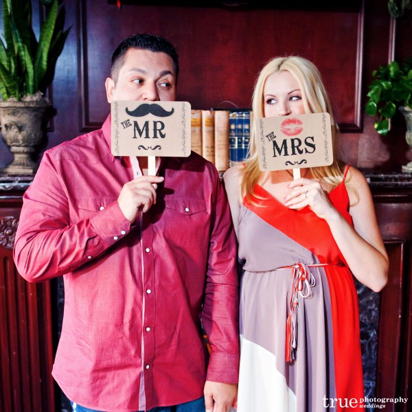 San Diego Wedding Photography: Engagement Photos with signs and props in downtown San Diego