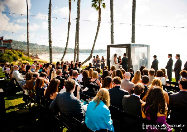 San Diego Wedding Photography: String lights during outdoor wedding ceremony at Scripps Seaside Forum
