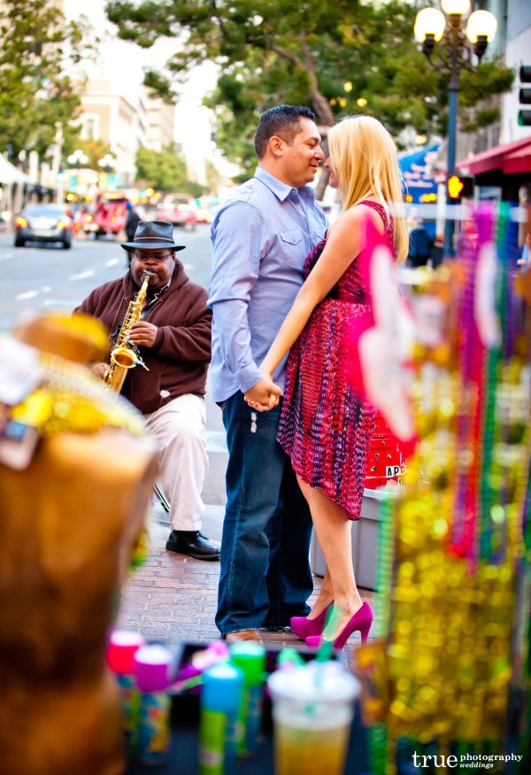 San Diego Wedding Photographers photography engagement shoot in downtown San Diego with Mardi Gras beads