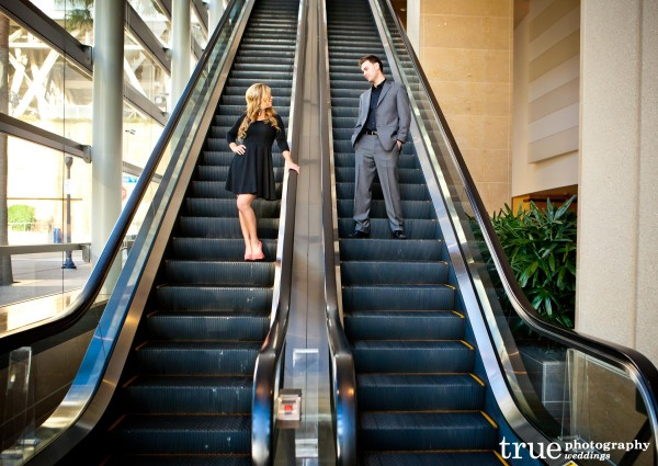 San Diego Wedding Photography: Engagement photo shoot on escalator at the Omni Hotel