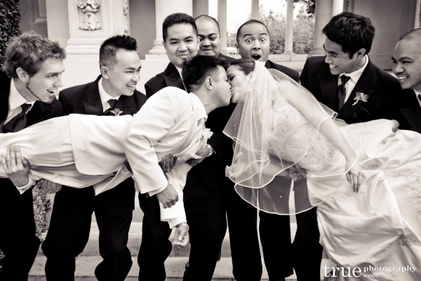 San Diego Wedding Photography:  Bridal party holding bride and groom up for a kiss