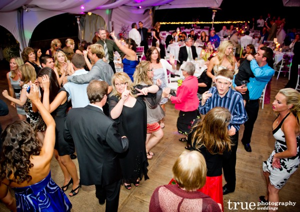 Guests dancing at Pala Mesa wedding with music by Music Phreek DJ and Lighting
