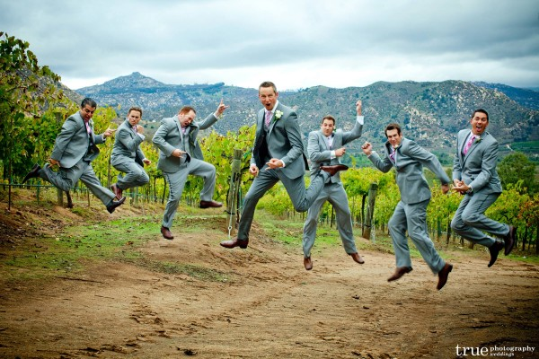 San Diego Wedding Photography: Temecula winery wedding with Groomsmen acting silly