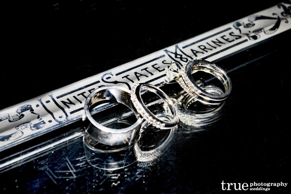 Military wedding in San Diego photo of US Marine sword with wedding rings