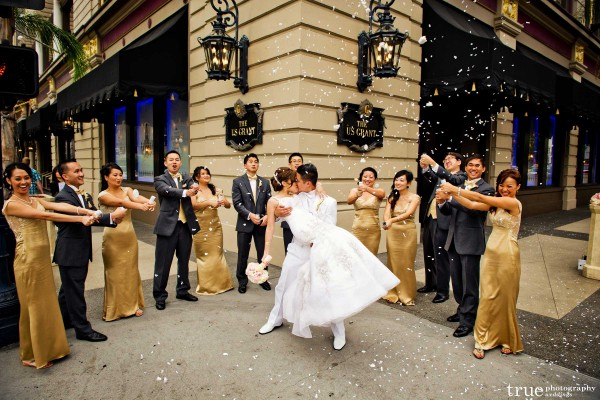 San Diego Wedding Photography: Wedding Party throwing confetti during wedding in downtown San Diego