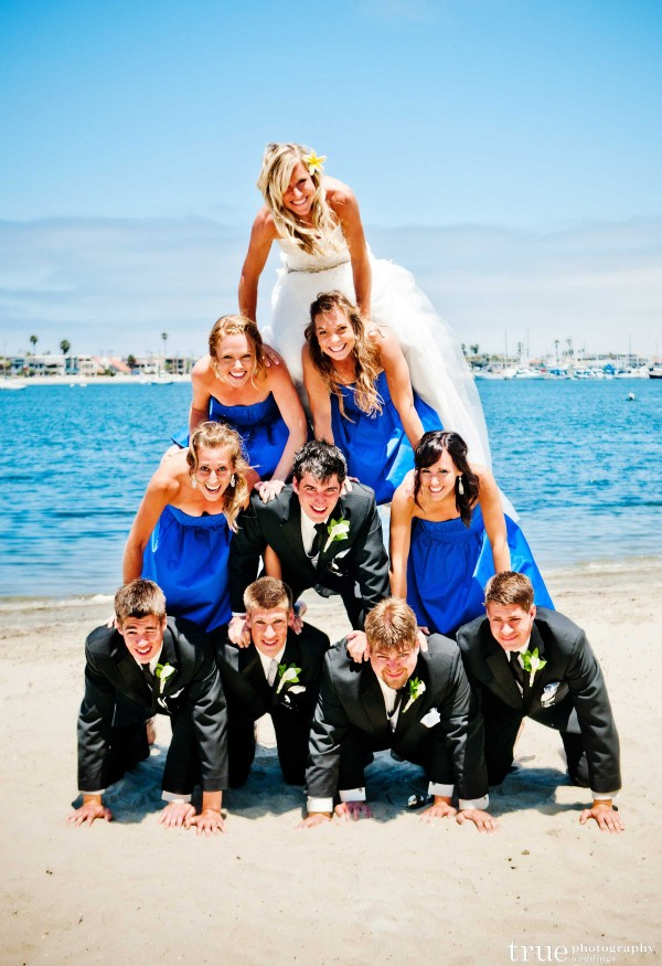 San Diego Wedding Photographer: Wedding Party making a human pyramid on the beach