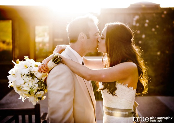 Beautiful and romantic wedding photo of bride and groom at Scripps Seaside Forum wedding with I Do Weddings