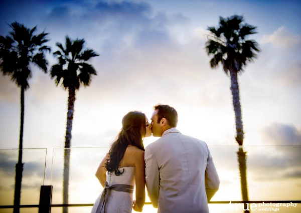 Bride and Groom Kissing during beach wedding at Scripps Seaside Forum with I Do Weddings
