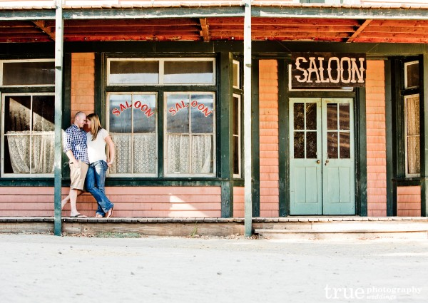 Engagement photo shoot by old saloon with True Photography