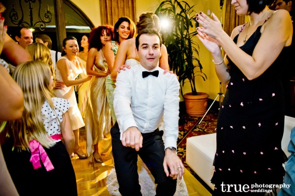 The-groom-dancing-at-The-Crosby-Club-Wedding