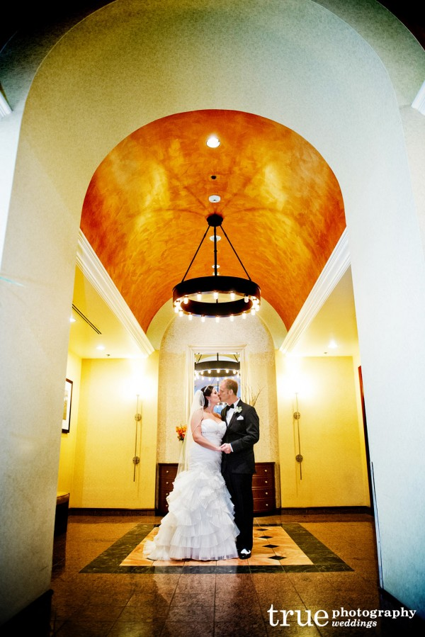 bridal-couple-under-arch