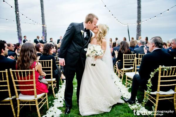 bride-groom-kiss-aisle