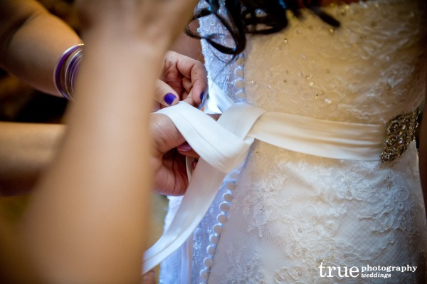 bride-tying-dress