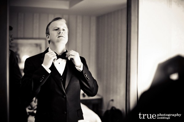 groom-straightening-tie