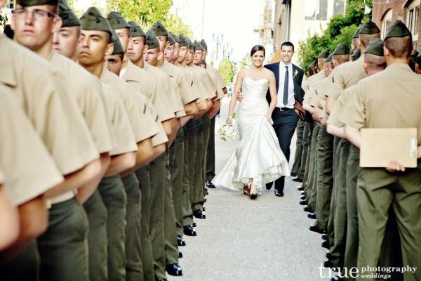 Bride and groom walking between military officers San Diego Wedding