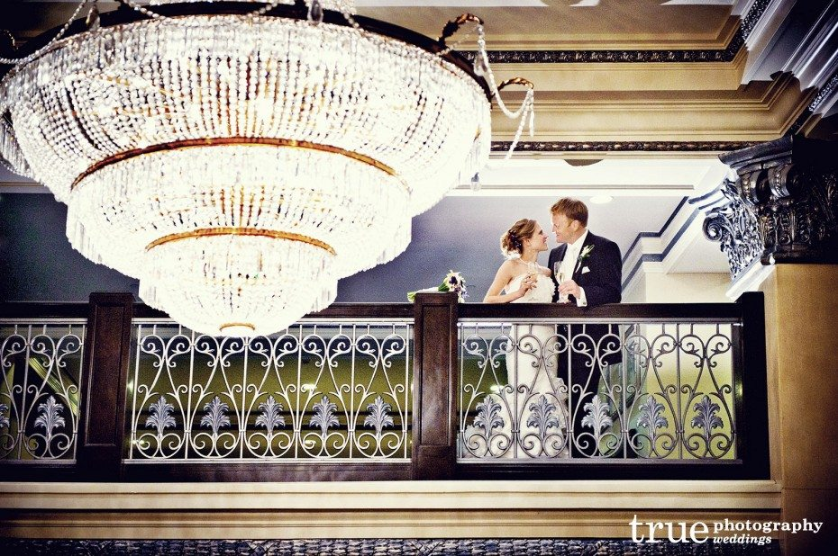 bride-groom-sharing-champagne-on-balcony