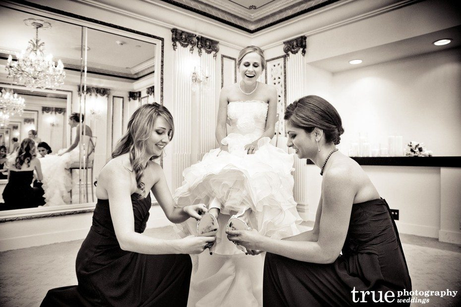 bride-putting-on-shoes