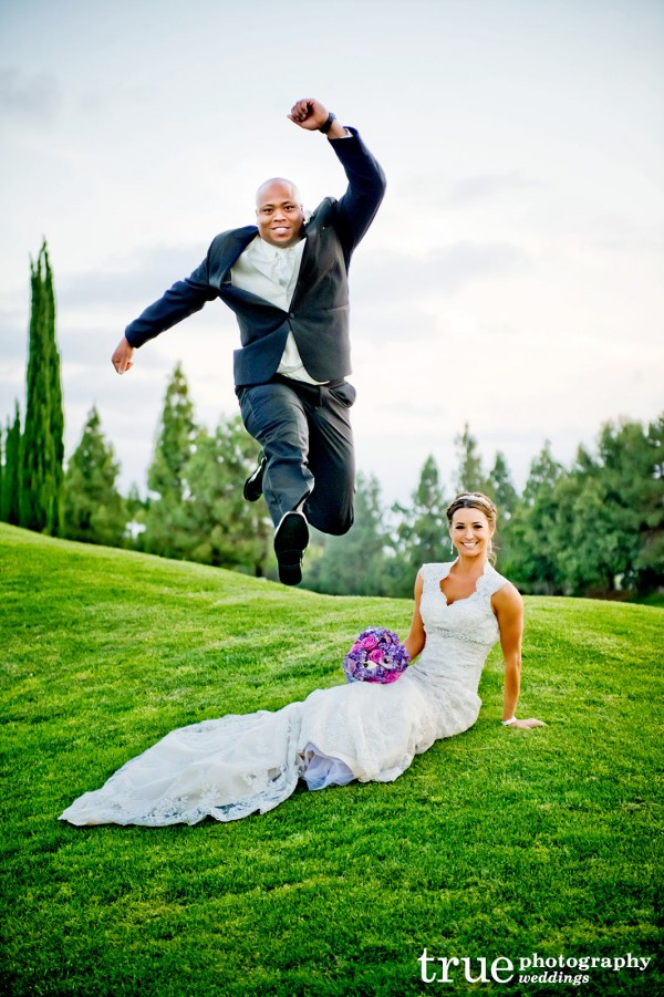 groom-jumping-over-bride-on-grass