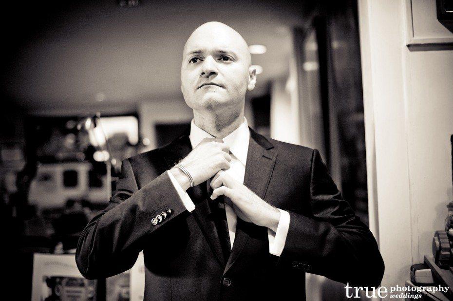 groom-straightening-tie