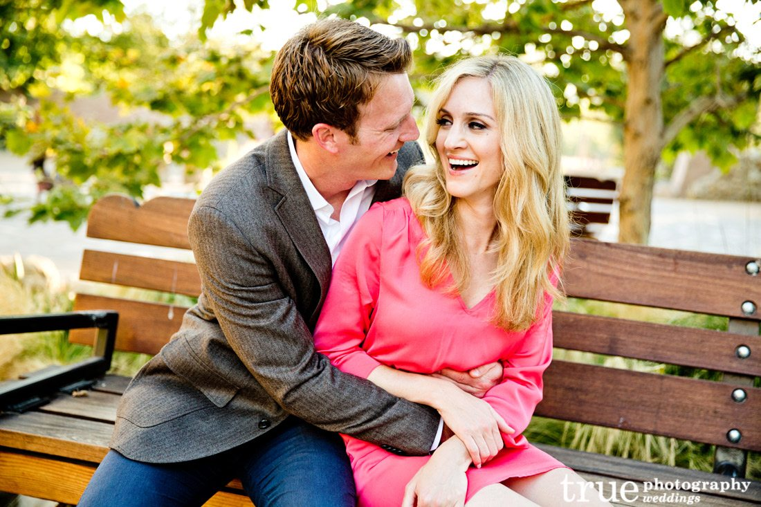 Engagement-photo-laughing-on-bench-