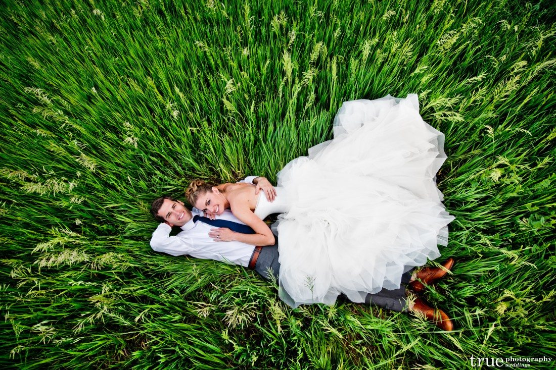 wedding couple in grass denver botanic gardens at chatfield