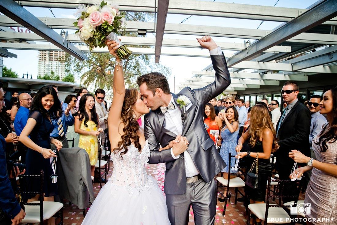 celebratory first kiss at wedding