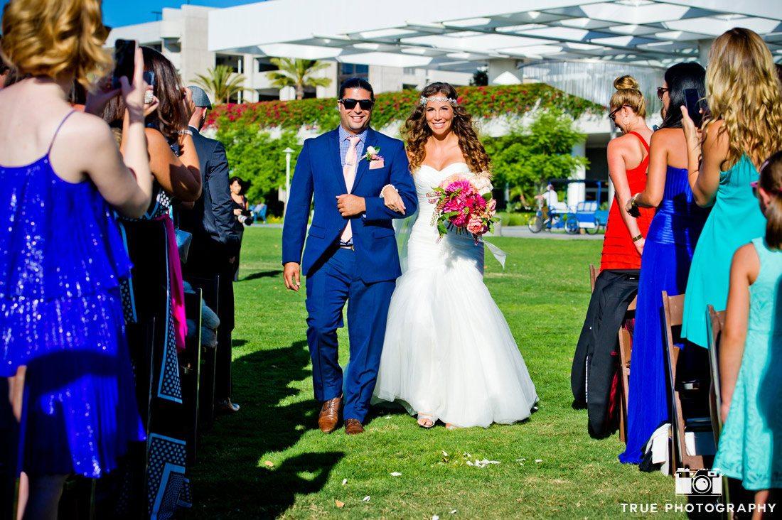 bride being escorted into ceremony
