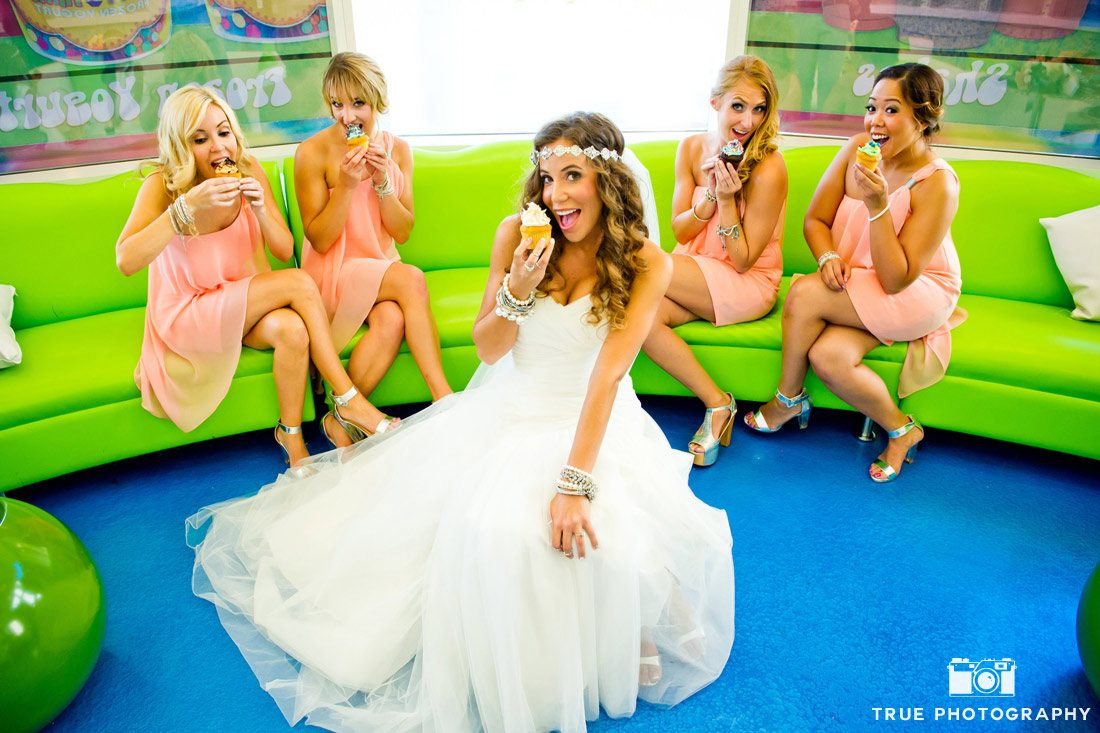 bride and bridesmaids eating cupcakes in sweet shop