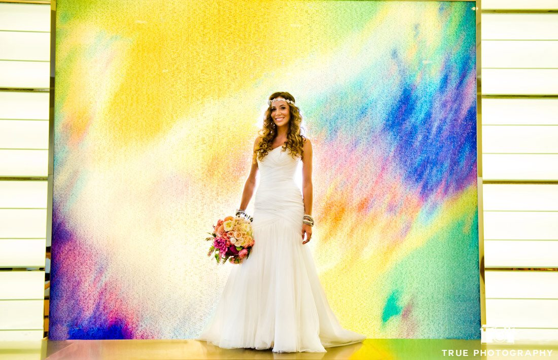 bride in front of digital rainbow background