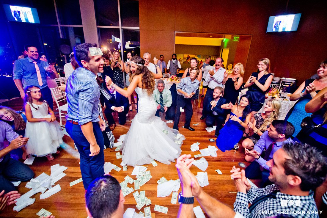 bride and groom laughing during money dance