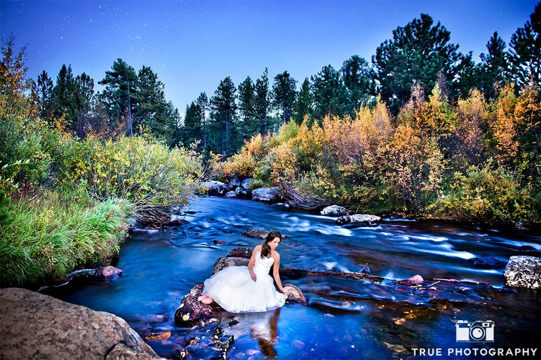 photo of bride at wild basin lodge in stream