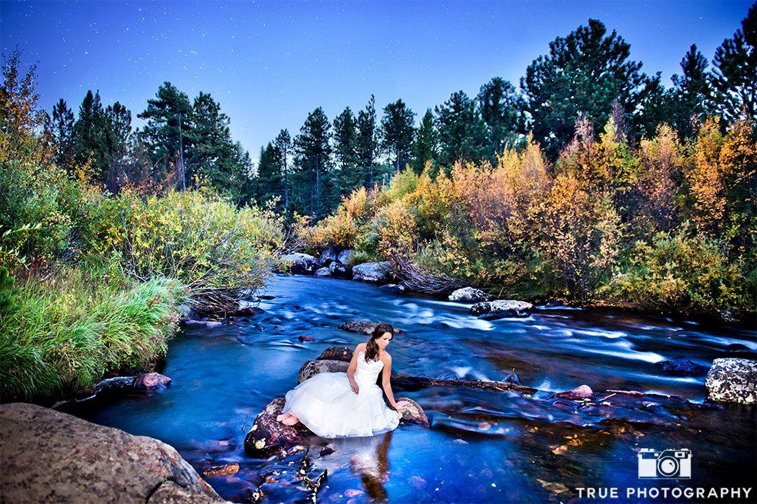photo of bride at wild basin lodge in stream
