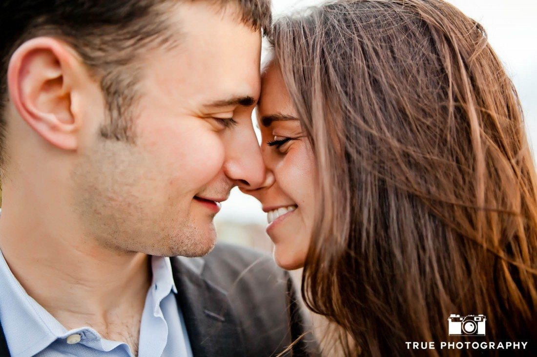 Engagement shoot of Del Mar Beach couple kissing close up