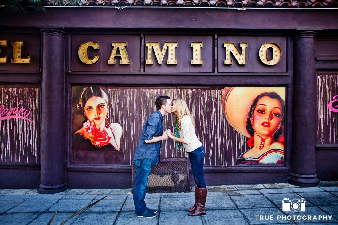 Little Italy Engagement shoot couple kissing in front of sign