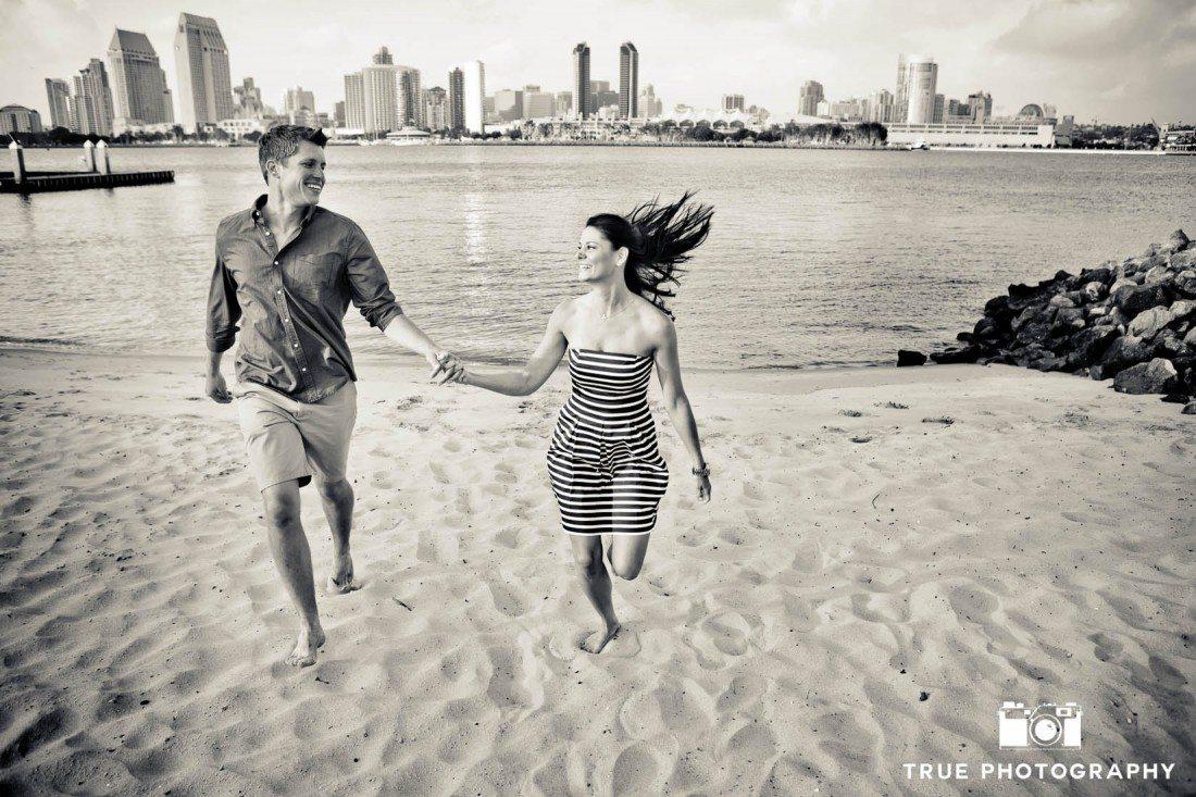 Coronado engagement photo shoot running on beach