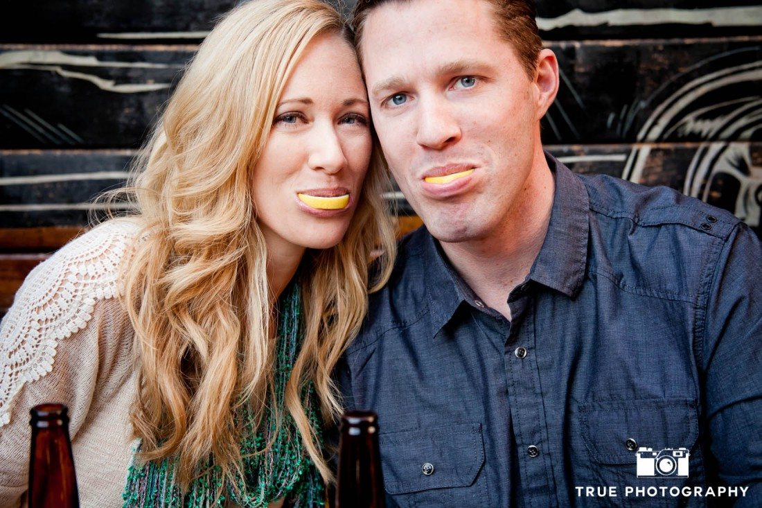Little Italy Engagement shoot couple lemons after tequila shot