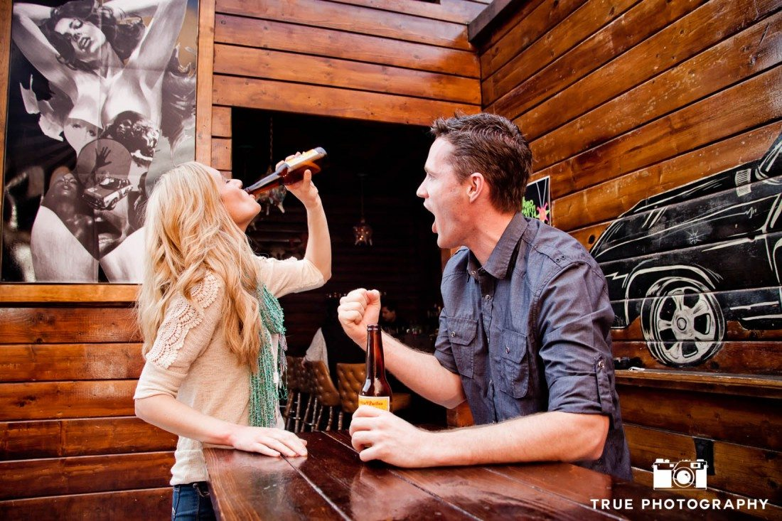 Little Italy Engagement shoot couple drinking beer