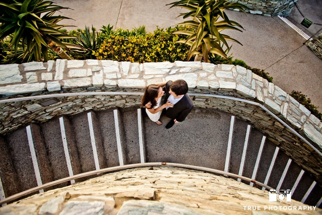 Engagement shoot of Del Mar Beach couple overhead on staircase
