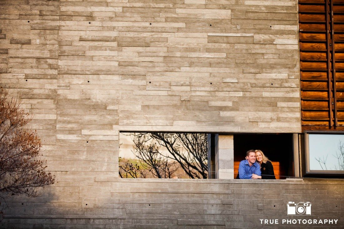 Little Italy Engagement shoot couple looking out from brick structure