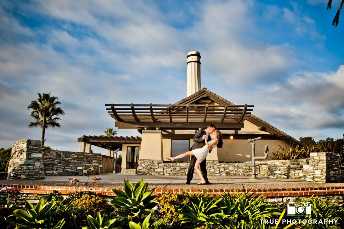 Engagement shoot of Del Mar Beach couple in front of building