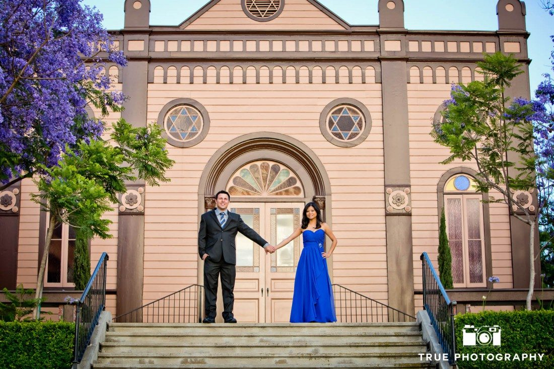 Old Town engagement shoot of couple standing at top of stairs