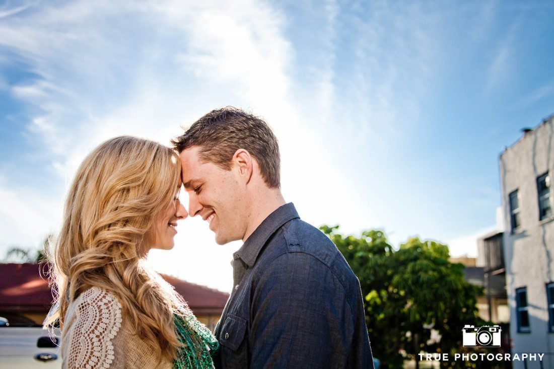 Little Italy Engagement shoot couple with blue sky