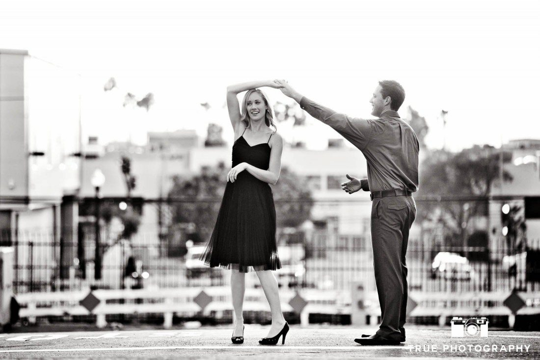 Little Italy Engagement shoot couple b&w in dancing pose