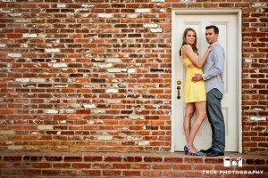 Old Town Couple Standing With Brick Wall And White Door San Diego Photographytrue Photography