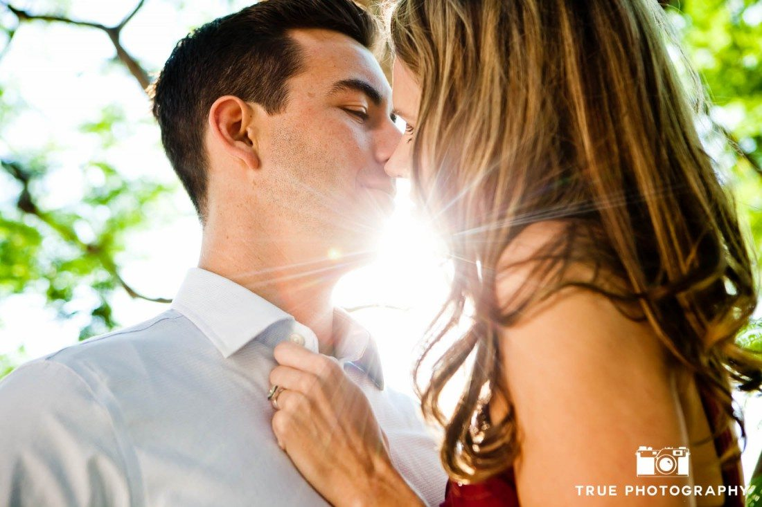 Old Town engagement shoot of couple kissing in sunlight